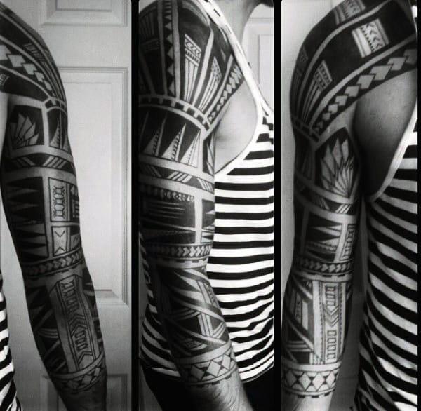 Tribal Arm Sleeve Tattoo On Man