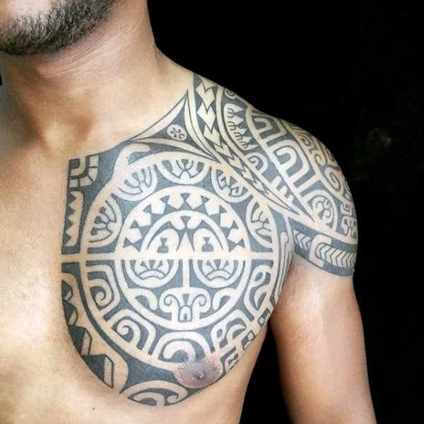 Tribal Chest And Arm Tattoos For Males