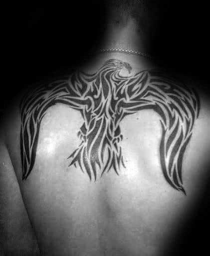 Tribal Eagle With Wings Spread Out Guys Back Tattoos