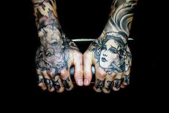 Portrait And Tribal Hand Tattoos