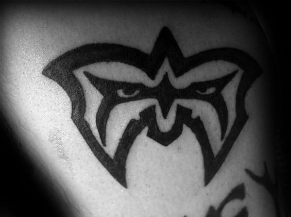Tribal Mask Small Arm Mens Wrestling Tattoo Design Inspiration