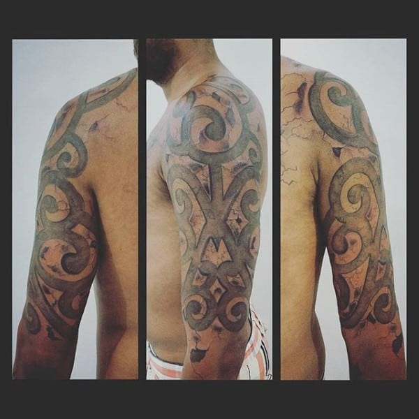 Tribal Stone Half Sleeve Tattoo On Man