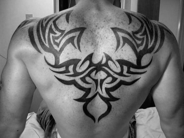 60 tribal back tattoos for men bold masculine designs. Black Bedroom Furniture Sets. Home Design Ideas