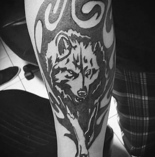 Tribal Wolf Walking Mens Inner Forearm Tattoo