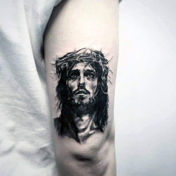tricep-small-religious-jesus-portrait-tattoo-for-men