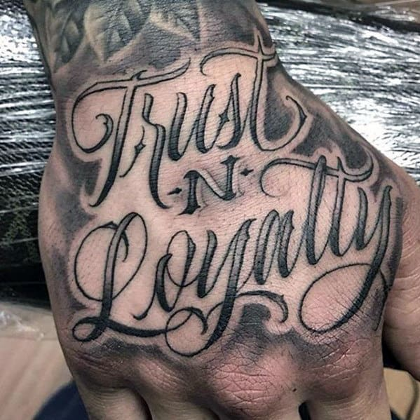 Trust And Loyalty Script Badass Mens Hand Tattoos