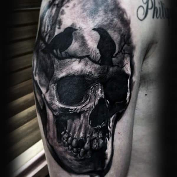 Two Crows Sitting On Tree Branch With Skull Upper Arm Tattoo For Males