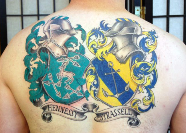 Two Family Crest Tattoos On Mens Back