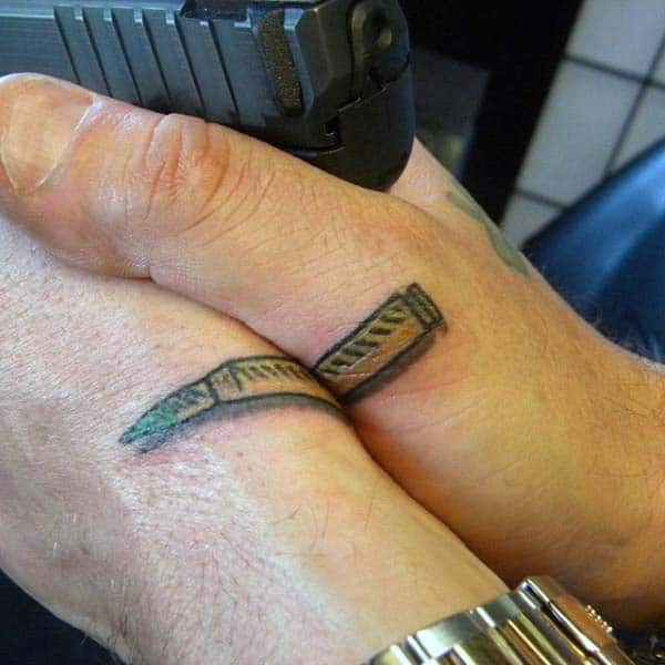 Two Hands Bullets Tattoo For Guys Above Fingers