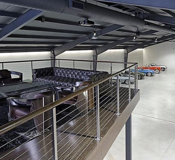 Two Story Lounge Mens Dream Garage With Classic Cars