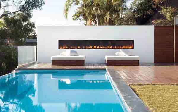 Ultra Modern Luxurious Rectangular White Stone Outdoor Fireplace Designs By Infinity Edge Pool