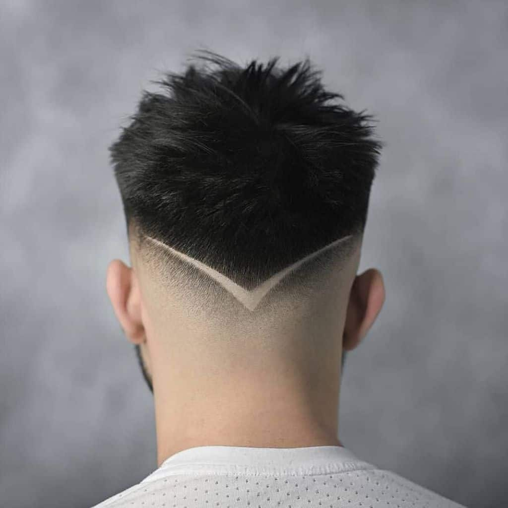 A low burst fade haircut with an undercut at the nape of the neck