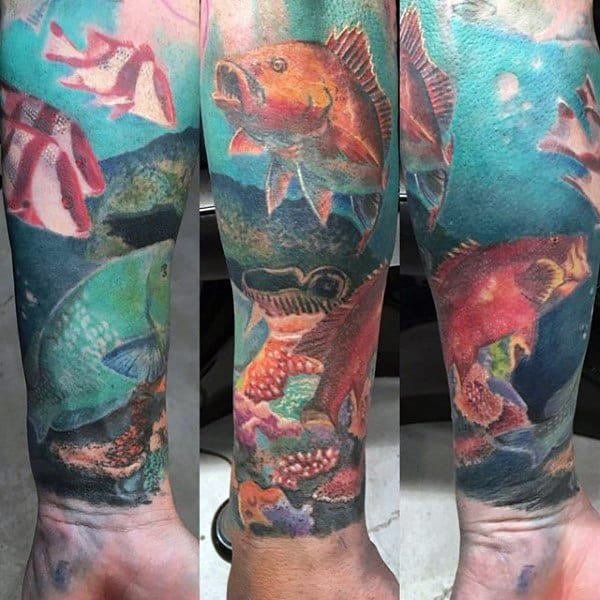 Underwater Tropical Fish Swimming Tattoo On Wrist For Men