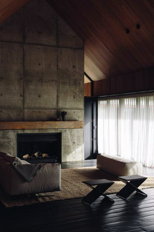 Unfinished Concrete Fireplace Design With Wood Mantel Beam