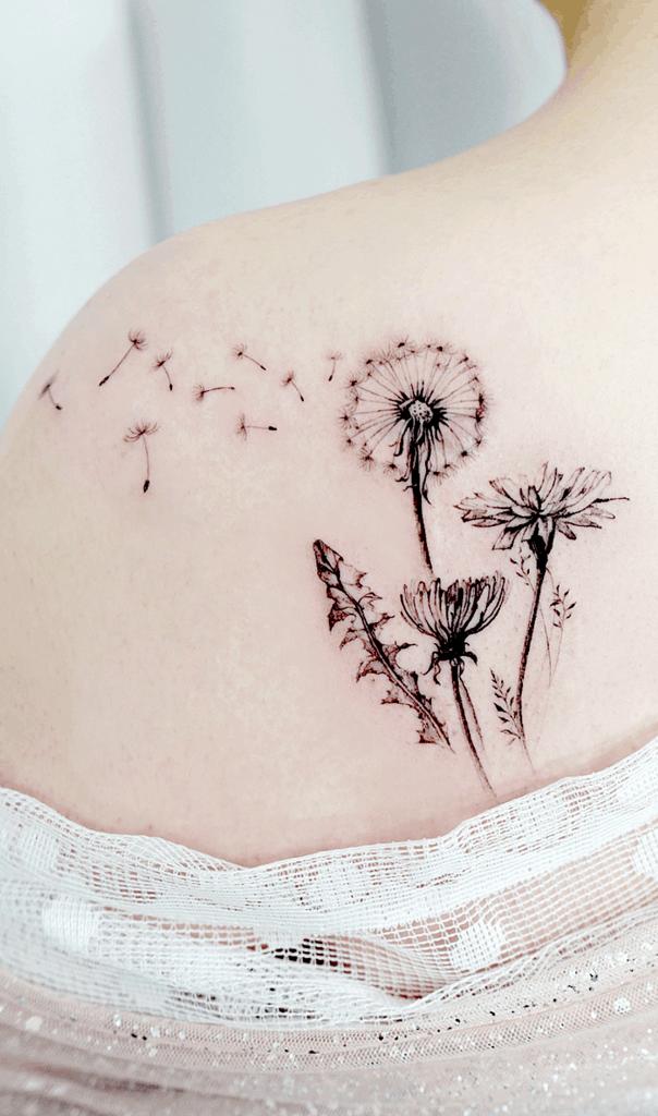 unique back dandelion tattoo.png