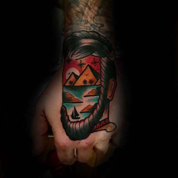 Unique Hand Face With Egyptian Pyramids Mens Tattoo Designs