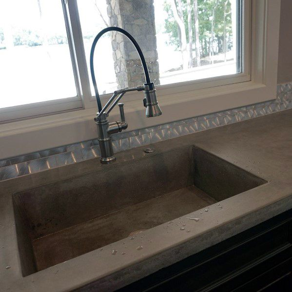 Unique Metal Backsplash Designs With Concrete Countertops And Sink