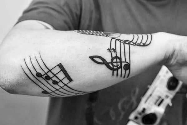 Unique Outer Forearm Black Ink Mens Music Staff Tattoos