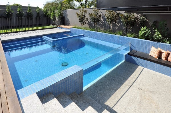 Unique Pool Fence Concrete Wall With Vertical Metal Bars