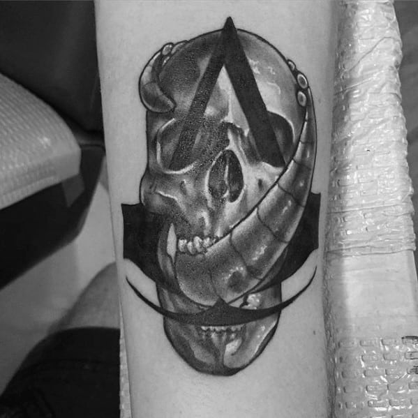 abb25371d38f3 Unique Skull Assassins Creed Logo Mens Video Game Forearm Tattoo