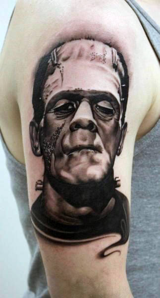 Upper Arm Black Ink Shaded Male With Tattoo Of Frankenstein