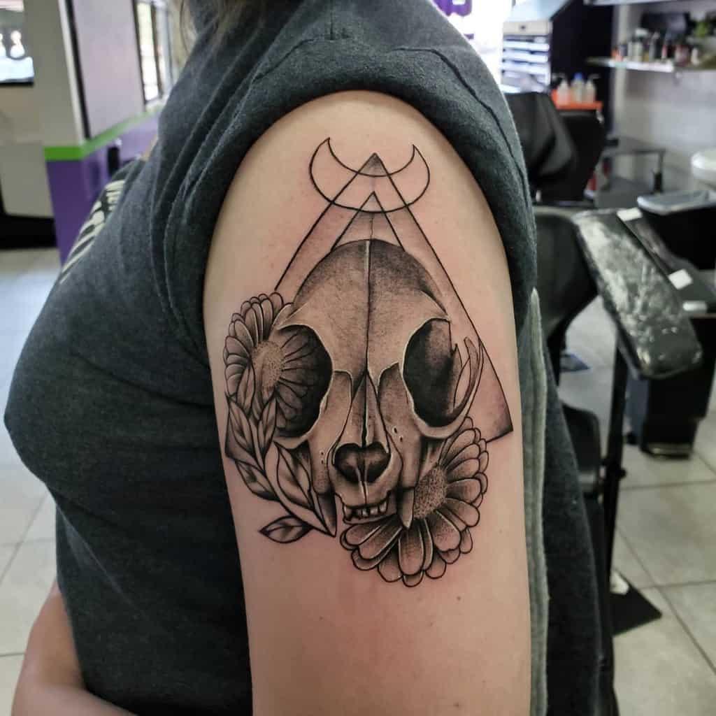upper arm cat skull tattoo andeaninktattoo