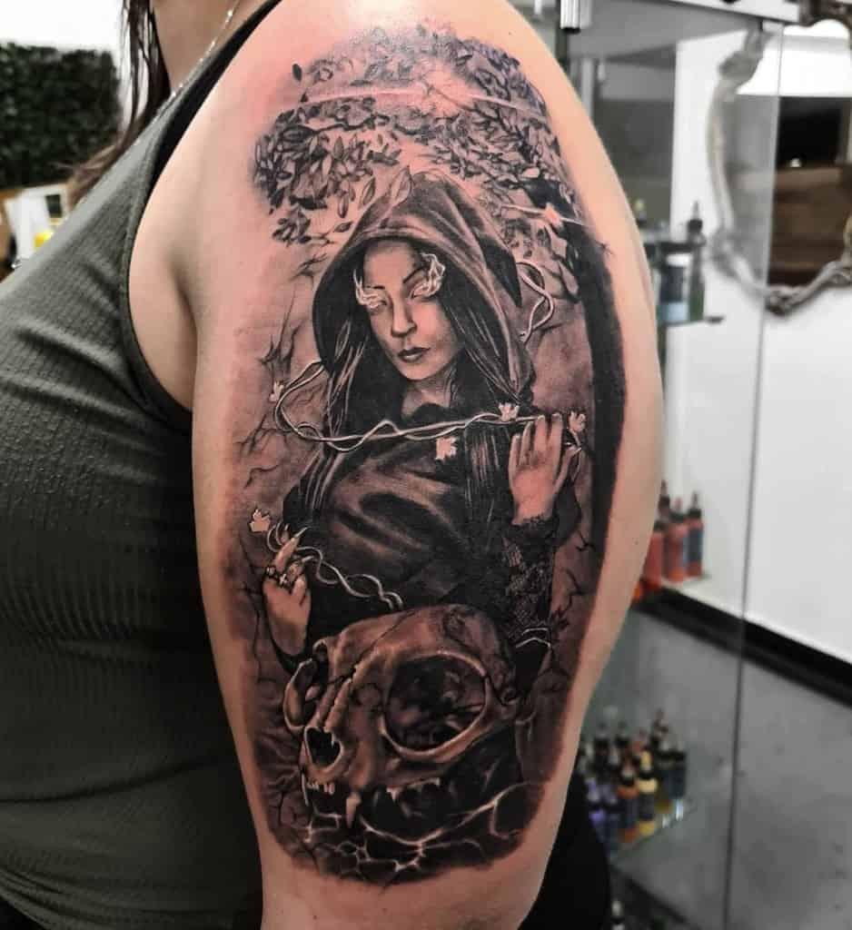 upper arm cat skull tattoo dolanbtattoo