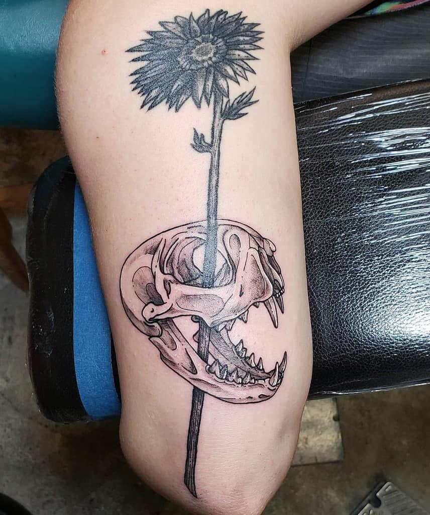 upper arm cat skull tattoo skinpeck