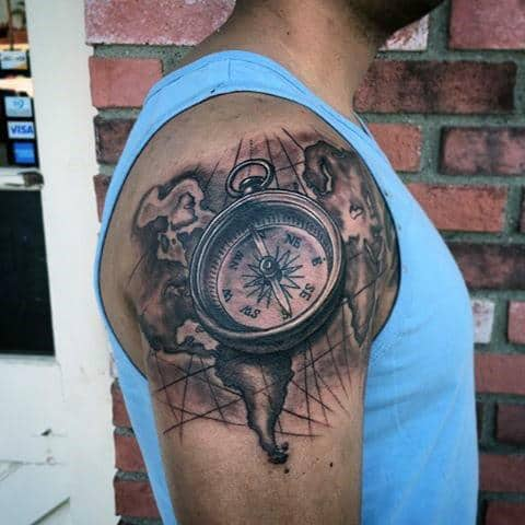 75 travel tattoos for men adventure design ideas upper arm compass and map travel inspired tattoos for gentlemen gumiabroncs Image collections