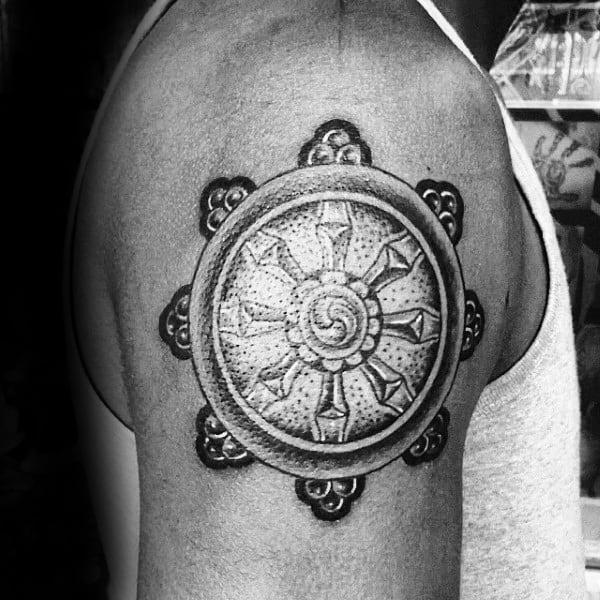 Upper Arm Male Dharma Wheel Tattoo