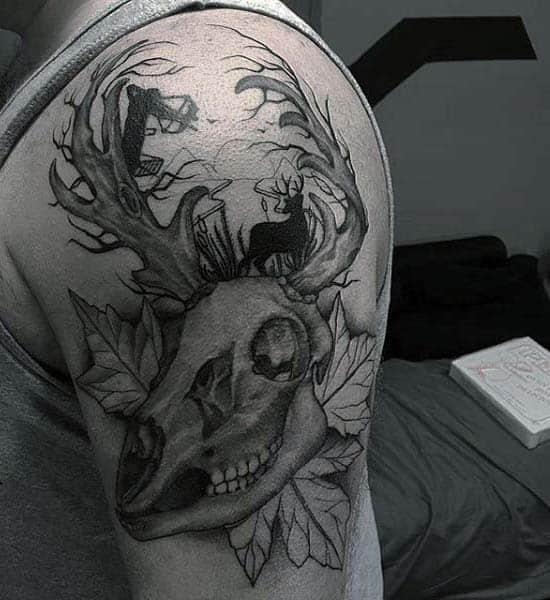 Upper Arm Male Tattoo Of Deer Skull And Archer Firing Arrow
