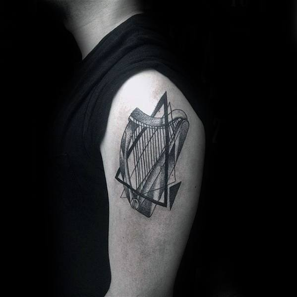 Upper Arm Male With Cool Harp Tattoo Design