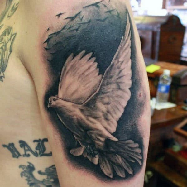 Upper Arm Male With Tattoos Of Doves And Clouds
