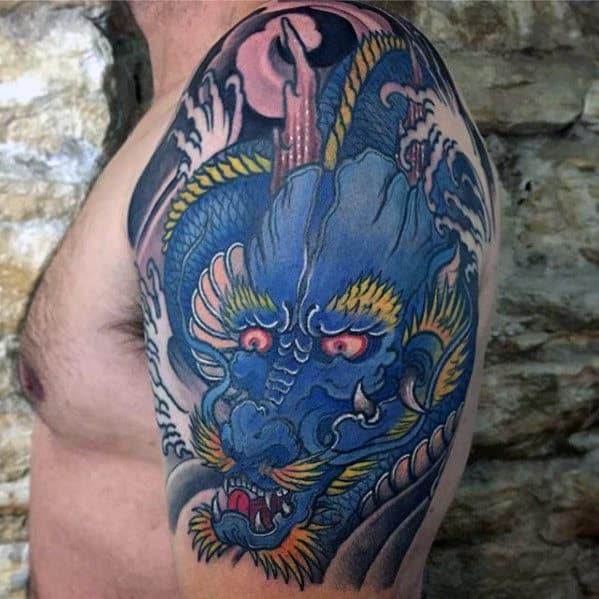 Upper Arm Mens Blue Dragon Tattoo Designs