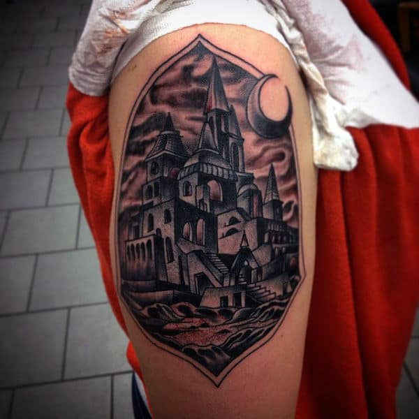 Upper Arm Moon And Castle Shield Tattoo For Males