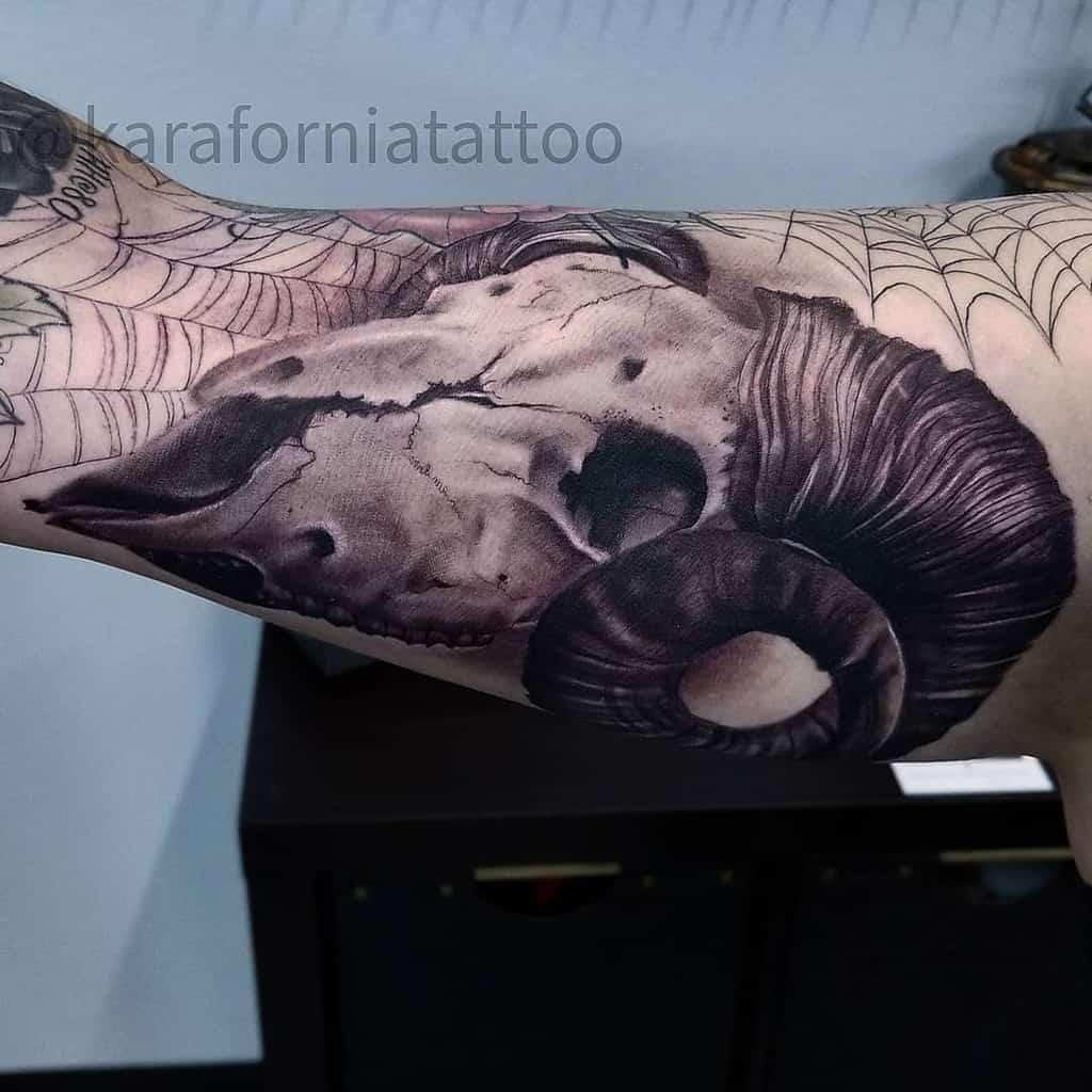 upper arm ram skull tattoo karaforniatattoo