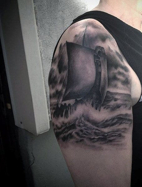 Upper Arm Ship Viking Style Tattoo On Men