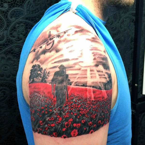 Upper Arm Solider Walking In Poppy Field Mens Tattoo