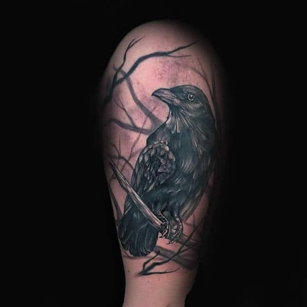 Upper Arm Tree Branches With Crow Tattoo On Male