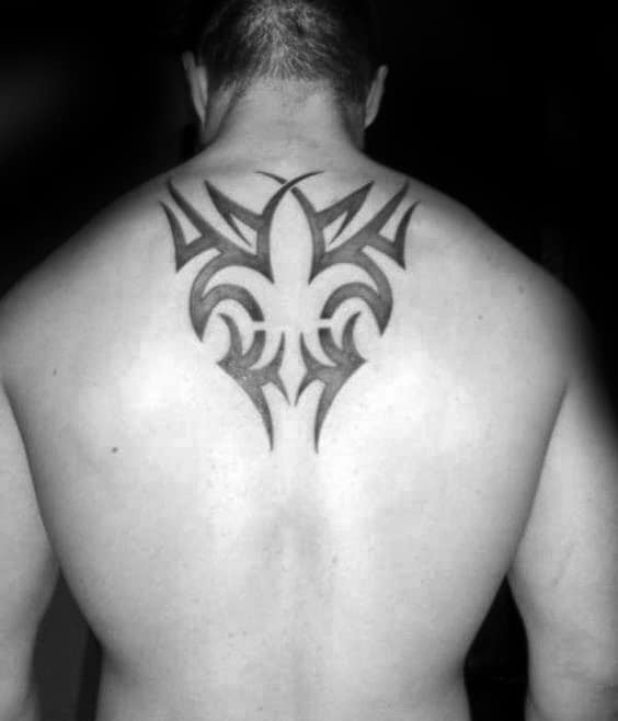 Upper Back Fleur De Lis Negative Space Tribal Tattoos For Guys