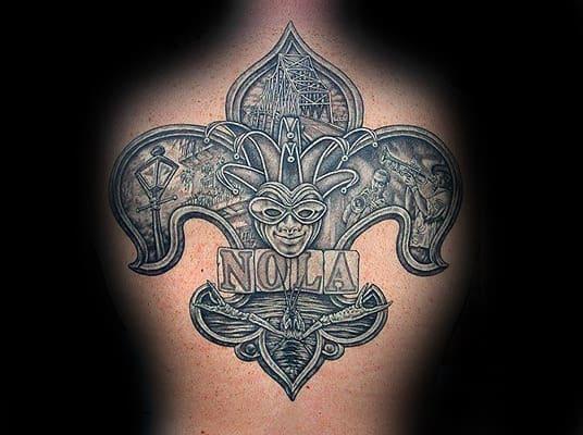 Upper Back Fleur De Lis Tattoo On Male