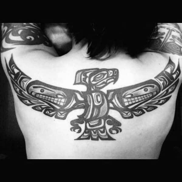 Upper Back Flying Bird Mens Animal Tribal Tattoo Design Inspiration