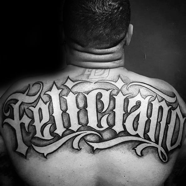 Upper Back Last Name Negative Space Manly Mens Tattoo Ideas