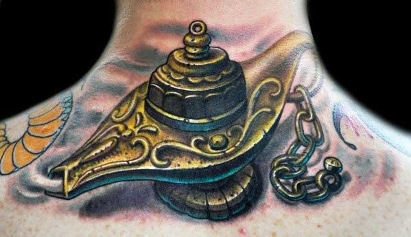 Upper Back Ornate Golden Genie Lamp Tattoos For Gentlemen