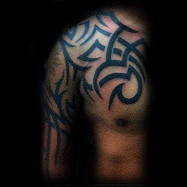 Upper Chest And Arm Male Traditional Tribal Tattoo Inspiration