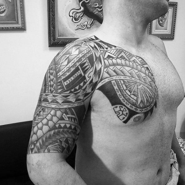 Upper Chest And Half Sleeve Tribal Tattoo On Guy