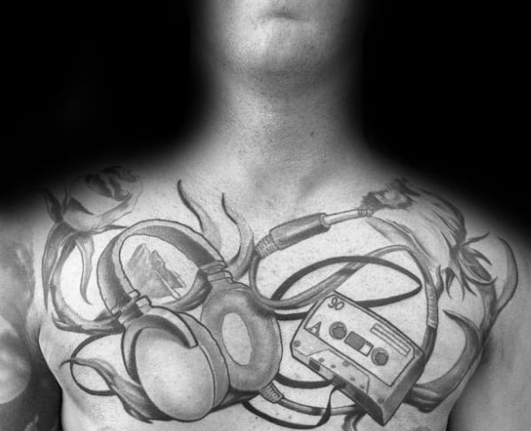 Upper Chest Artistic Male Headphones Tattoo Ideas