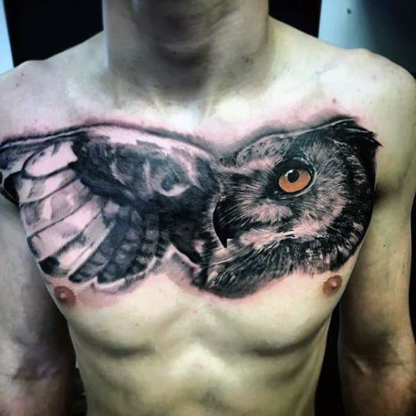 Upper Chest Black Ink Shaded Owl Tattoo For Men With Orange Eye