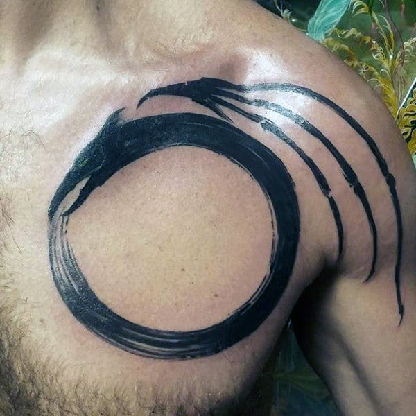 Upper Chest Circle Ouroboros Mens Tattoo Ideas