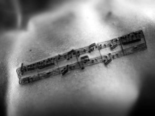 Upper Chest Music Staff Tattoo Design Ideas For Males